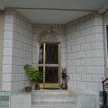 Entrata esterna decorata con effetto rivestimento