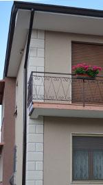 Tinteggiatura esterna con decorazione di un'abitazione a Nuvolera (Brescia)